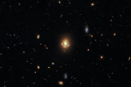 Hubble uses cosmic optical illusion to spy a quasar 17 billion light-years away